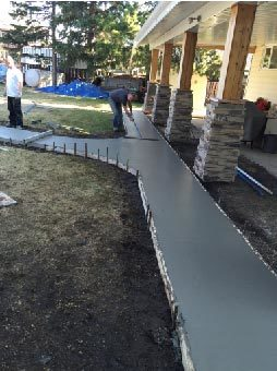 Residential home concrete walkway construction
