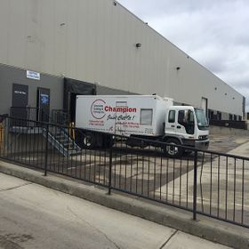 Champion Concrete Cutting Inc. truck at loading bay