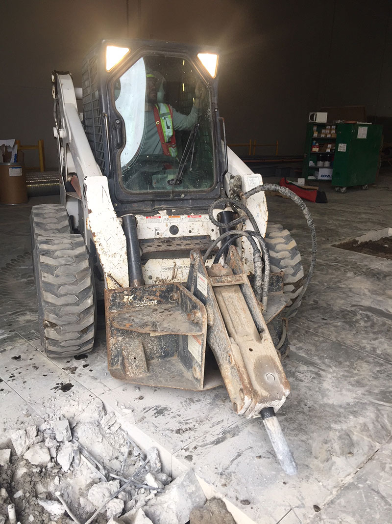 Bobcat with jack hammer attachment